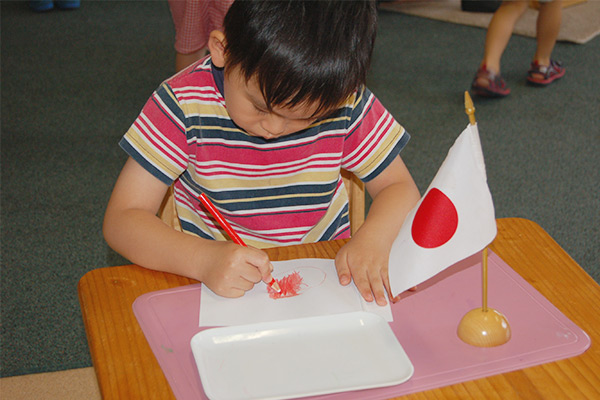 boy-colouring-japanese-flag