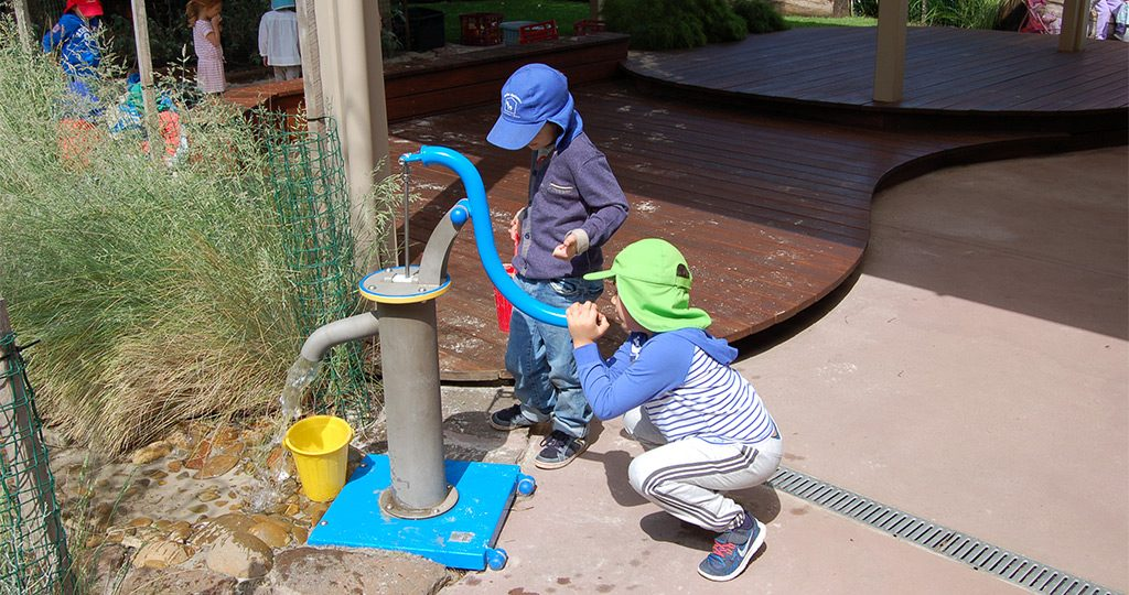 boys-filling-up-water-in-garden