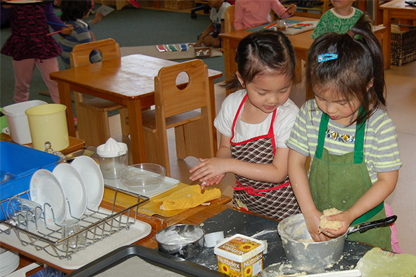 two-girls-learning-daily-activity-cooking-washing