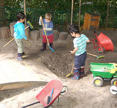 preschool-students-playing-in-sandpit
